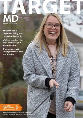 front cover of Spring edition of Traget MD, showing a woman holding a dog leash
