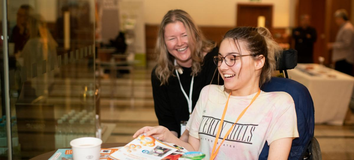Two delegates share laughing together in the coffee break at the Muscular Dystrophy UK 2019 conference
