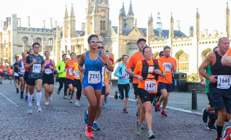 Runners running the route of Muscular Dystrophy UK's Cambridge Town and Gown 10k
