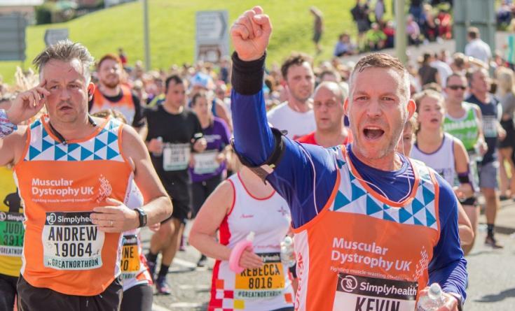 runners in Team Orange tshirts