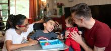 The Wilson family sat in their living room playing with their son Aadi who has SMA Type 2